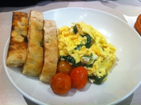 Scrambles eggs with spinach, feta served with toasted flat bread