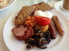 Free range eggs poached, baked beans, grilled tomato, sausages, hash brown, mushrooms and bacon on wholemeal toast