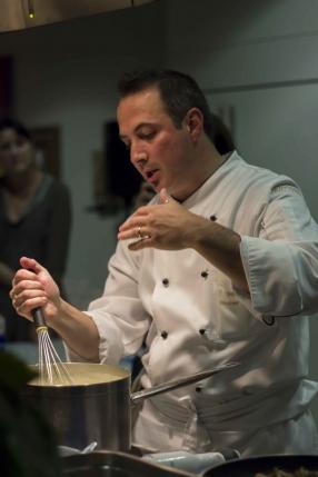Chef Andrea Tranchero mixing soup
