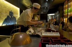 Preparing the swordfish with eggplant on bamboo