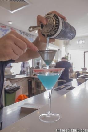 straining-the-lemon-blueberry-martini
