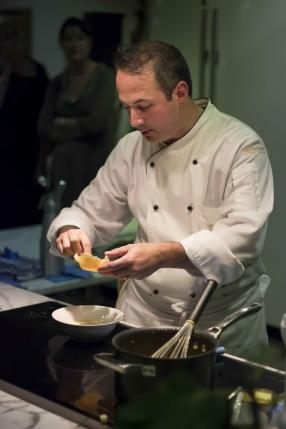 Chef Andrea preparing parmesan cheese basket
